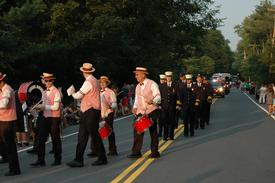 The Dixie Dandies leading in the South Salem Fire Department at the front of the parade