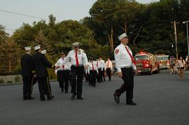 The Vista Fire Department, one of many neighboring departments marching in the parade, being greeted by the three SSFD Chiefs