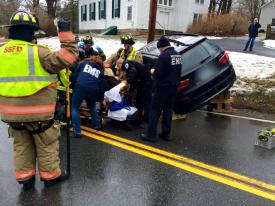Once the vehicle is stabilized, Firefighters assist the EMT's in getting the driver out of the car